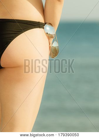 Woman Bottom In Black Bikini Panties And Glasses