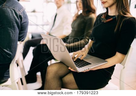 Close Up Of Young Woman With Laptop At Meeting Of Teambuilding Work Or Presentation In Office