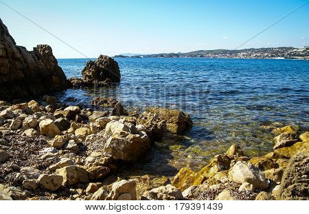 Landscape with sea, clear sky and rocky seashore of Cote d'Azur, France