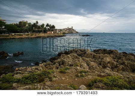 Landscape with sea, cloudy sky and rocky seashore of Cote d'Azur, France