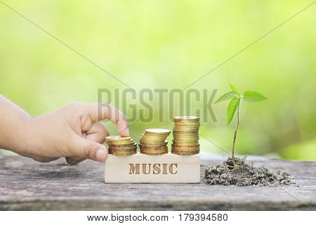 MUSIC WORD Golden coin stacked with wooden bar