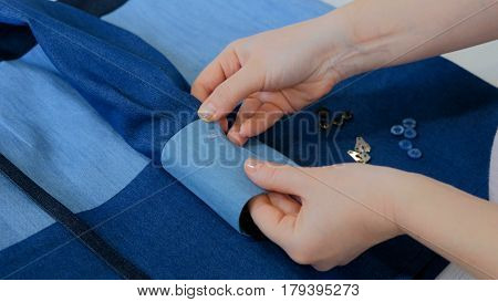 Professional tailor, designer measuring suit jacket for sewing at atelier. Fashion and tailoring concept