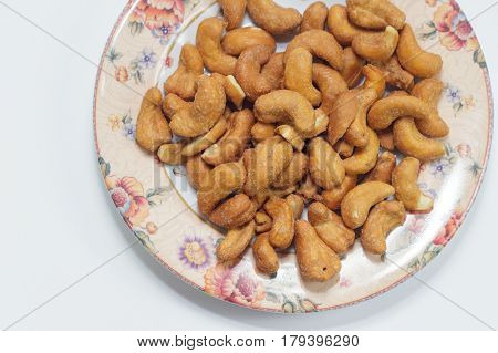 View of roasted salted cashew nut in bowl.Research shows that eating more nuts,such as cashews,can lower the risk for cardiovascular disease.