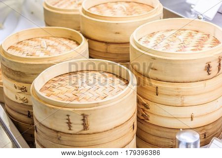 Stack of Chinese Bamboo Steamer dim sum in bamboo steamer chinese cuisine