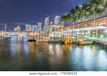MIAMIFLORIDA/USA - DECEMBER 31 2016: Bayside Marketplace at night on December 31 2016 in Miami Florida. It is a festival marketplace and the top entertainment complex in Downtown Miami attracting 15M people annually.