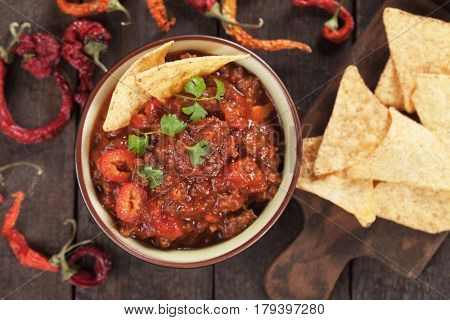 Mexican chili con carne served with tortilla chips
