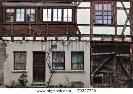 Wall of the old half-timbered house with wooden frame and white filling. Besigheim, Baden-Wuerttemberg, Germany.