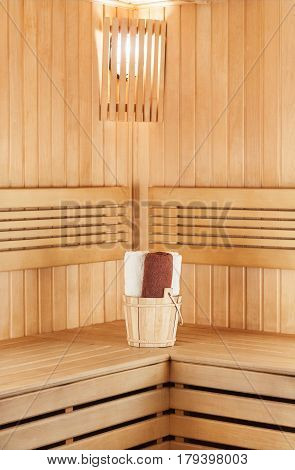 Traditional Wooden Sauna For Relaxation With Bucket