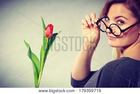 Seducive Nerdy Girl Holding Tulip.