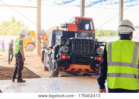 Supervisor worker checking a construction site works