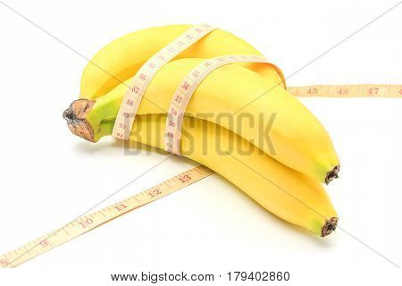 Measuring tape wrapped around a banana isolated on a white background Concept of diet.
