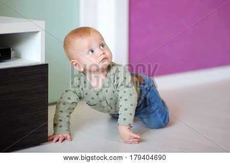 Portrait of Little baby boy playing at home