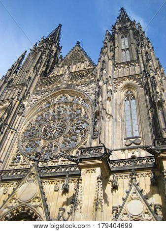 St. Vitus Cathedral (Metropolitan Cathedral of Saints Vitus, Wenceslaus and Adalbert), roman catholic cathedral in Prague, Czech Republic. Front facade gothic architecture view on summer sun day