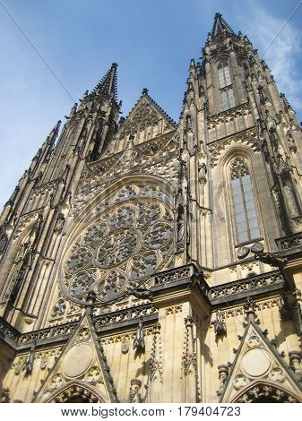 St. Vitus Cathedral also known Metropolitan Cathedral of Saints Vitus, Wenceslaus and Adalbert, roman catholic cathedral in Prague, Czech Republic. Front facade gothic architecture view on summer day