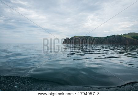 Morning sky over crystal waters of the deepest lake Baikal, Russia