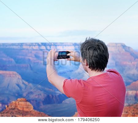 Tourist Making Mobile Photo Of The Famous Grand Canyon