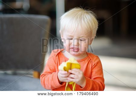 Toddler Boy Eating Banana