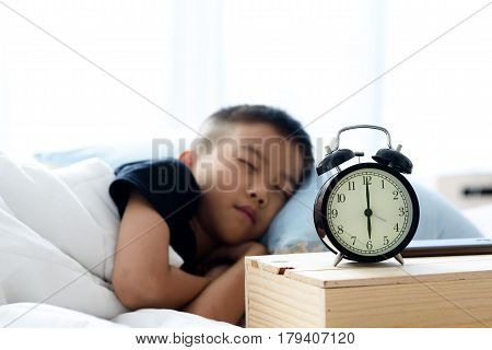 Sleeping Boy And Alarm Clock