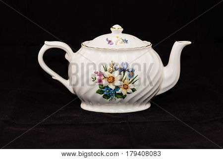 white teapot (six and a half inches high, nine inches long)
