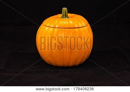 pumpkin shaped candy dish (six inches high, five and a half wide)