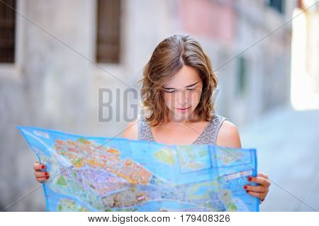 Young Woman With Paper Map In Venice, Italy