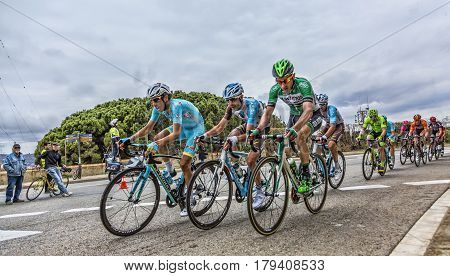 Barcelona Spain - March27 2016: Group of cyclists including Fabio Aru of Team Astana riding on the road to the top of Montjuic in Bracelona Spain during Volta Ciclista a Catalunya on March 27 2016.