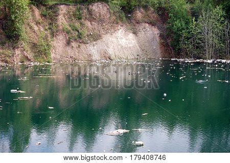 Environmental pollution. Industrial quarry with ejected debris.