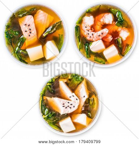 Set of japanese miso soup, isolated at white. Top view, flat lay. Miso soup with salmon, seafood and chicken