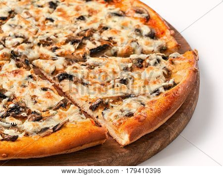 Close up view on piece of pizza with mushrooms and cheese on wooden cutting board. Isolated on white with clipping path