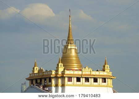 Chedi of the ancient Buddhist temple Wat Sacket (Temple of the Golden Mount) against the background of a cloudy sky. Bangkok, Thailand poster