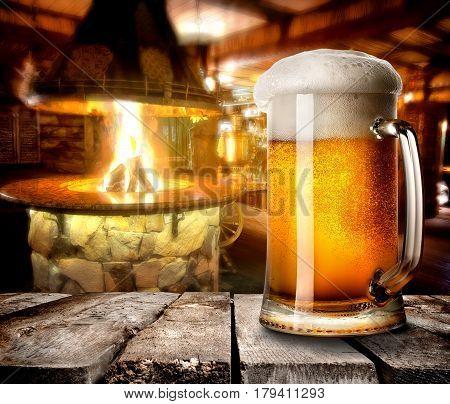 Mug of foamy beer on wooden table in bar
