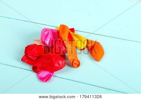 pile Blown air balloons on wooden background