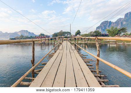 Wooden bridge across Nam Song river to riverside guesthouse at Vang vieng Laos