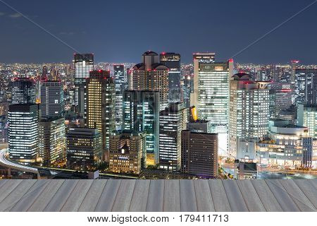 Opening wooden floor city office building business downtown night view Osaka Japan