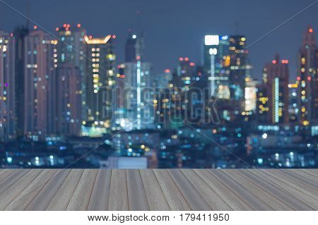 Opening wooden floor Twilight blurred bokeh light city downtown night view abstract background