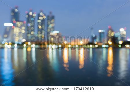 Night blurred bokeh office building and reflection abstract background