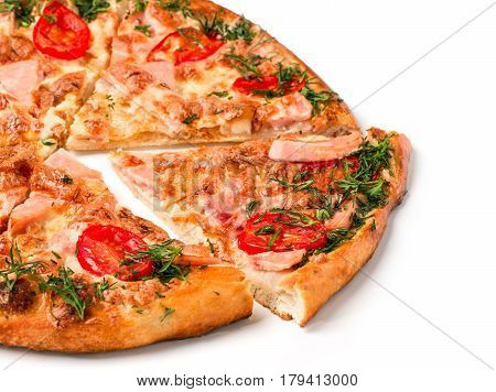 Close up view on piece of pizza with ham on wooden cutting board. Isolated on white with clipping path