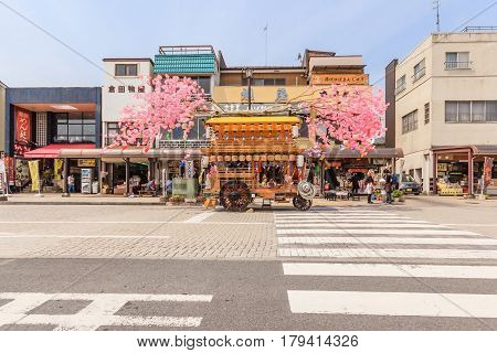 NIKKO JAPAN - APRIL 16 2014: A wooden hana-yadai is being walk around in downtown of Nikko to celebrate and welcome spring season with fancy Japanese costume Nikko Japan