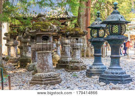Stone pillar and metal lanterns in Toshogu shrine in Nikko Japan