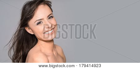 Portrait of a young beautiful and smiling young woman. Wonderful smile on your face.