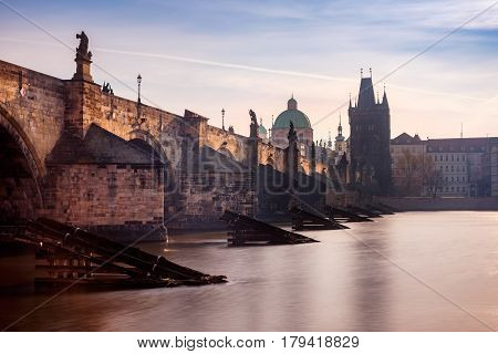 Scenic View Of Charles Bridge In Prague At Sunrise