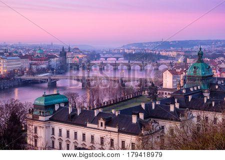 Scenic View Of Prague Bridges And Cityscape At Sunrise