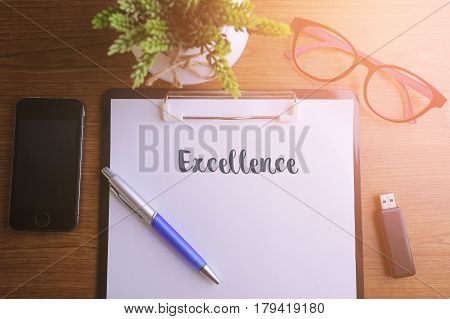 Business Concept - Top View Notebook Writing Excellence.