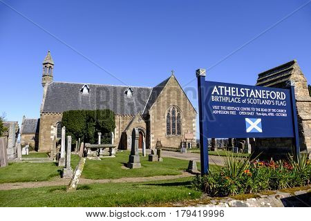 ATHELSTANEFORD EAST LOTHIAN SCOTLAND - 20 APRIL 2016 - Beautiful old stone church home of National Flag Heritage Centre in the pretty village of Athelstaneford East Lothian Scotland. Said to be the birthplace of Scotland's national flag St Andrew's Cross