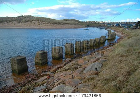 A Row of Tank Stoppers in Port Errol, Aberdeenshire