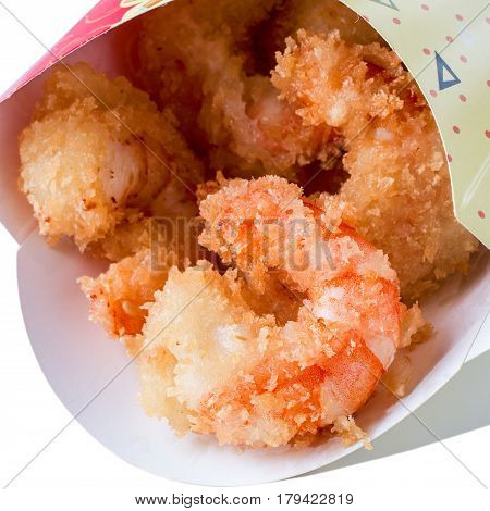 Close up view of fried tempura shrimps in paper box. isolated on white