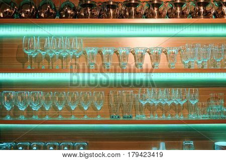 Display counter with various glass in bar at night background counter of bar and pub in dark night background