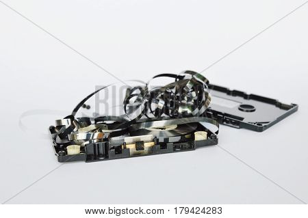 audio cassette tape dismantling parts on white background
