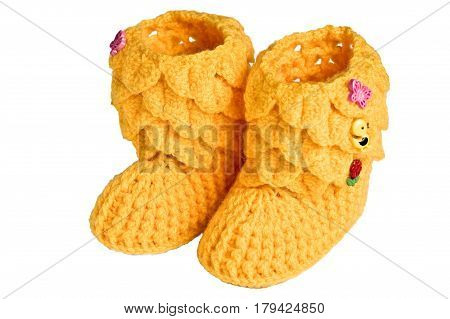 knitted, yellow booties for children on a white background