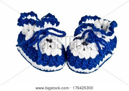 knitted, blue booties for children on a white background